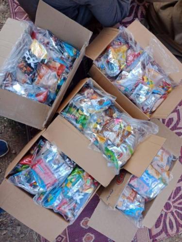 توزيع حلويات على الأطفال - أسوان - يناير 2019