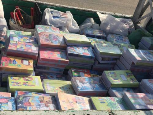 توزيع شنط مدرسية وملابس وأدوات كتابية - سوهاج - سبتمبر 2017