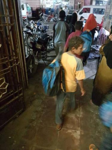توزيع شنط مدرسية وملابس - قنا وأسوان - سبتمبر 2016