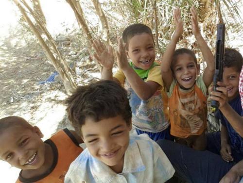 توزيع ملابس أطفال - قنا وأسوان - رمضان 1437